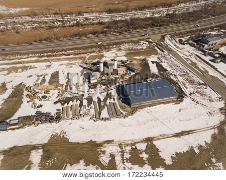 Exterior view of a cement factory. Concrete mixing silo, site construction facilities. Aerial view.