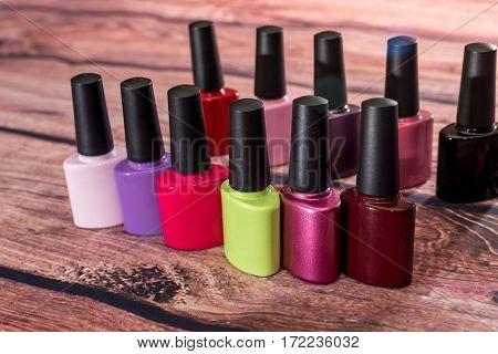 many nail polish bottle on desk .