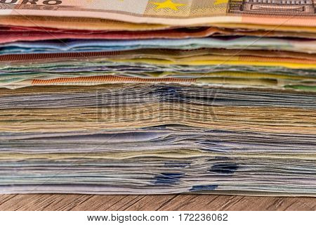 Folded Stack Of Dollar, Euro Banknotes As Background