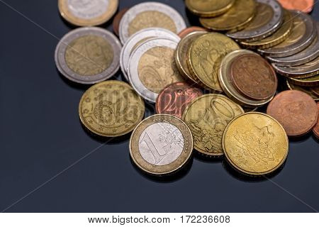 many euro coin isolated on dark background.