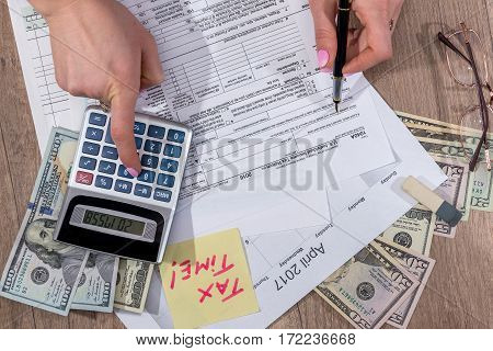 Woman Calculate Tax. Business Woman Working With Tax Documents. Dollar, Glasses, Pen.