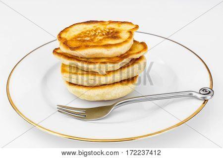 Lush sweet fritters on white plate. Studio photo