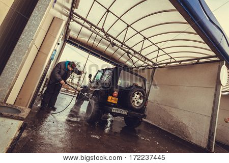 Leningrad region, Russia - February 18, 2017 Jeep Wrangler tj at the car wash, Wrangler is a compact SUV produced by Chrysler