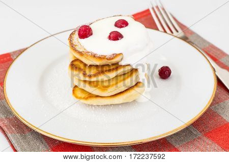 Delicious pancakes with berries and yogurt. Studio Photo