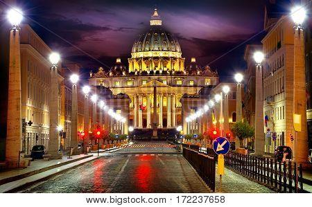 View of illuminated Saint Peter Basilica and Street Via della Conciliazione, Rome, Italy