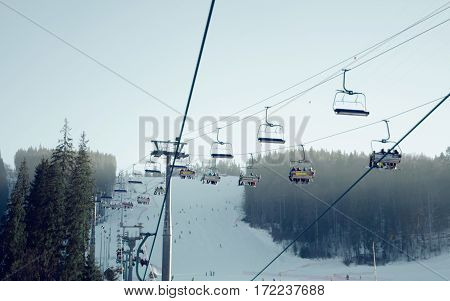 Bukovel ski lift in the snow fog