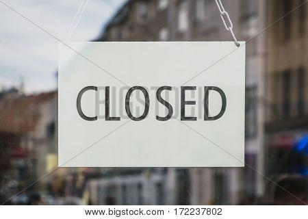 closed sign in shop entrance door - closed