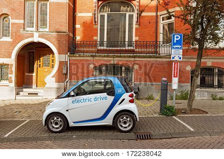 AMSTERDAM/ THE NETHERLANDS - OKTOBER 25, 2015: Electric drive car charging on street.