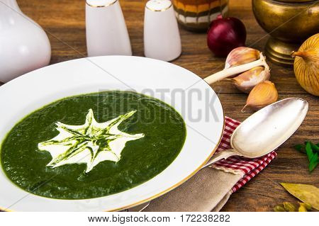Diet Cream of spinach soup with natural yogurt. Studio Photo