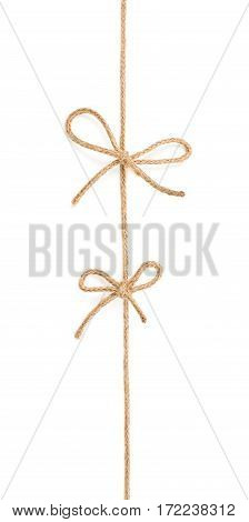 Two bow knots on a linen rope string isolated over the white background
