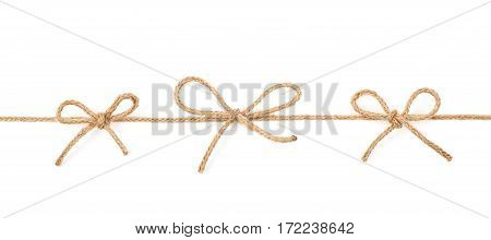 Three bow knots on a linen rope string isolated over the white background