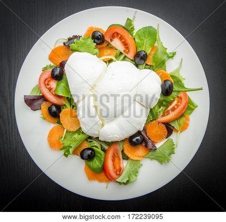 a fresh italian mozzarella with mixed salad