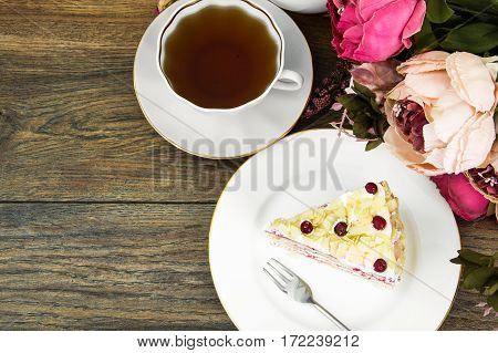Piece of sponge cake with berries and cream. Studio Photo
