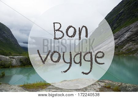 French Text Bon Voyage Means Good Trip. Lake With Mountains In Norway. Cloudy Sky. Peaceful Scenery, Landscape With Rocks And Grass. Greeting Card