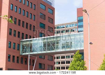 glass gangway between two office buildings in rotterdam netherlands
