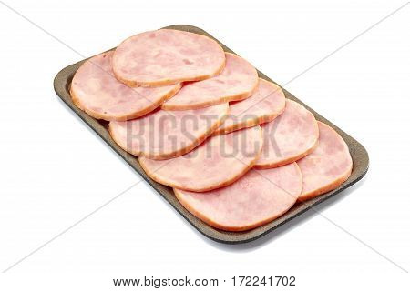 Sliced ham in retail tray isolated on white background