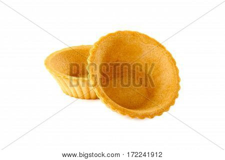 Two empty tartlets isolated on white background