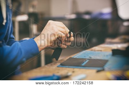 A man works with his hands