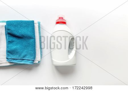 housekeeping set with towels and plastic bottles in laundry on white background top view mock up