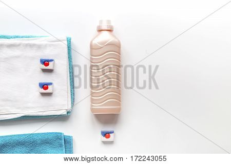 housekeeping set with towels and plastic bottles in laundry on white background top view mockup