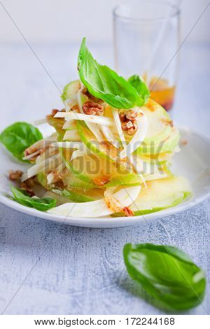 Fennel and apple salad on a wooden surface