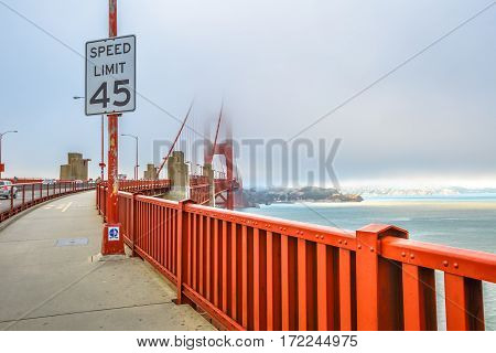 Golden Gate Bridge and popular red railing, San Francisco Bay, California, United States. Pedestrian perspective of bridge. Symbol and landmark of San Francisco. Travel and holidays concept.