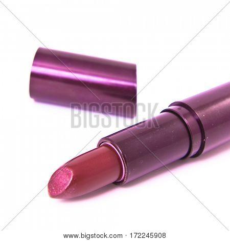 open lipstick on white background