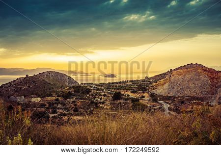 Colorful Sunset View Of Mountains And Sea And Dramatic Clouds On Aegina Island, Greece.