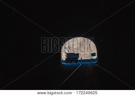 Way to light. Dark under hill tunnel in Iranian district
