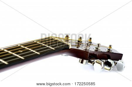 Detail of acoustic guitar with shallow depth of field on white background.