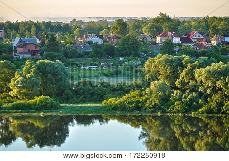 Spring landscape with countryside in the forest near the river in early morning, Birds eye view. Spring landscape from height. Colorful spring landscape view. Spring rural nature landscape