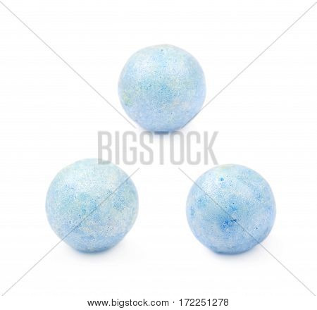Single blue colored foam ball or a corn cereal candy isolated over the white background, set of three different foreshortenings