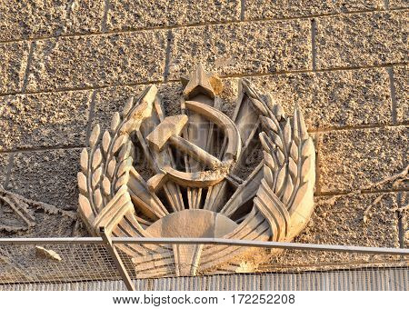 Coat of arms of the Soviet Union on facade of building in center of St.Petersburg Russia.