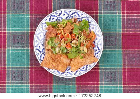 Spicy And Sour Mixed Herb Salad With Crispy Pork Served .