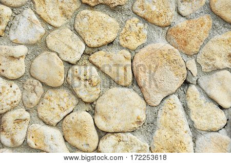 Background with stone wall from yelow rock material