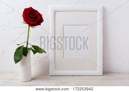 White frame mockup with dark red rose in vase. Empty frame mock up for presentation design.