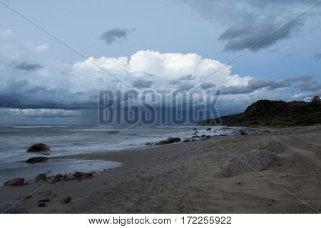 Storm clouds over the sea Stony shore