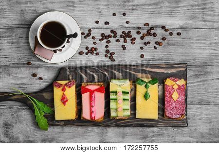 Breakfast for men. Figured snack sandwiches coffee chocolate. Sausage sandwiches cheese vegetables. Concept sandwiches Breakfast for day men father's day business lunch 23 February. Top view.