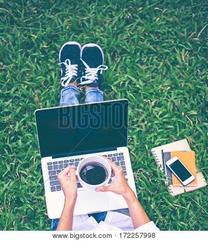 Women work in the park with labtop relax work
