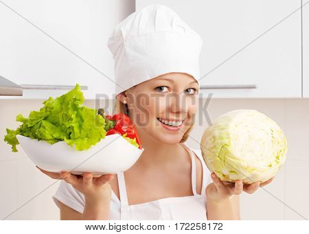 beautiful woman with vegetables in the kitchen