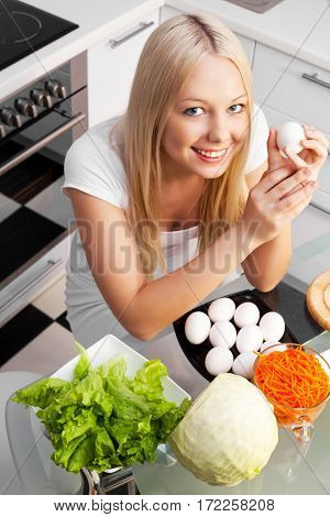 beautiful happy young woman cooking at home