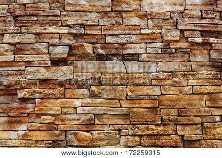 backdrop and texture of granite stone wall surface.
