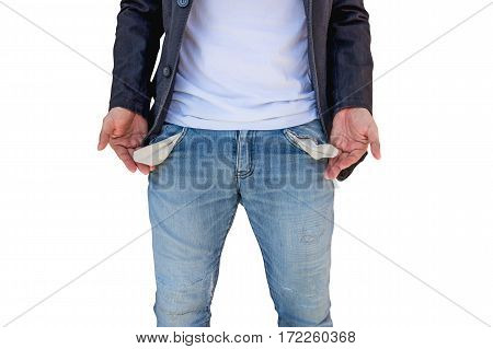Man showing his empty pockets isolated on white background.