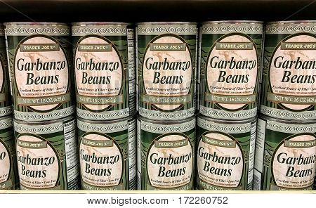 New York Februrary 14 2017: Cans of Garbanzo Beans are stacked on a shelf in a Trader Joe's store.