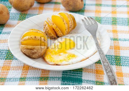 Baked Potatoes And Yellow Fried For Breakfast