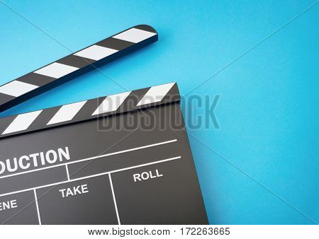 Clapper board on blue background