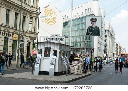 BERLIN, GERMANY- May 15, 2016 : Checkpoint Charlie. Former bordercross in Berlin on May 15, 2016. Berlin Wall crossing point between East and West during the Cold War. BERLIN, GERMANY
