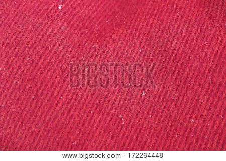 Background texture of wool blanket of red and purple. Macro texture of wool closeup.
