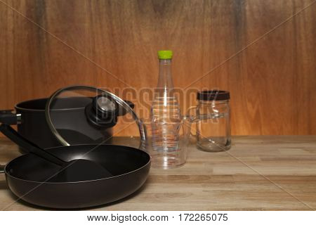 kitchenware cookware set on wood table wooden and light background