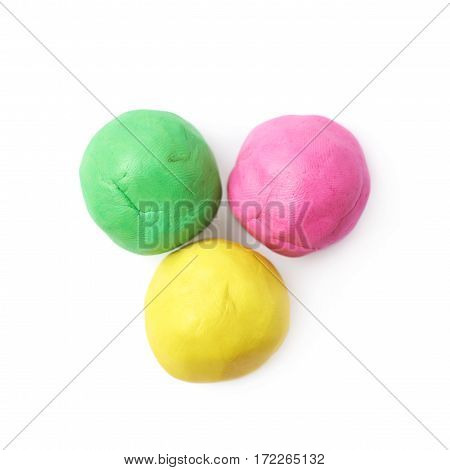 Pile of colorful plasticine balls isolated over the white background